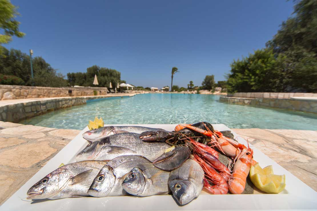 fresh fish by the pool italy